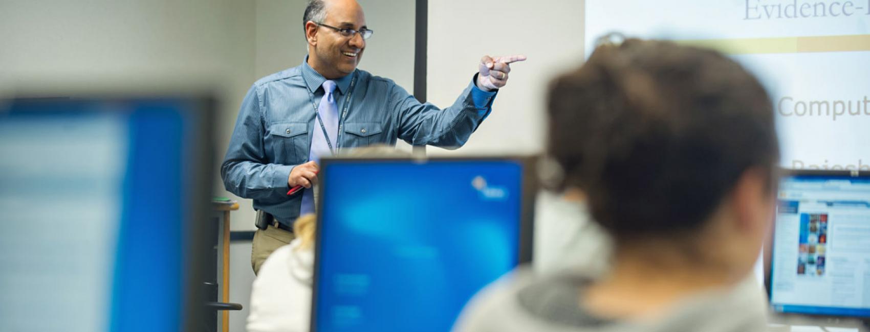 Dr. Rajesh Mangrulkar presenting in class