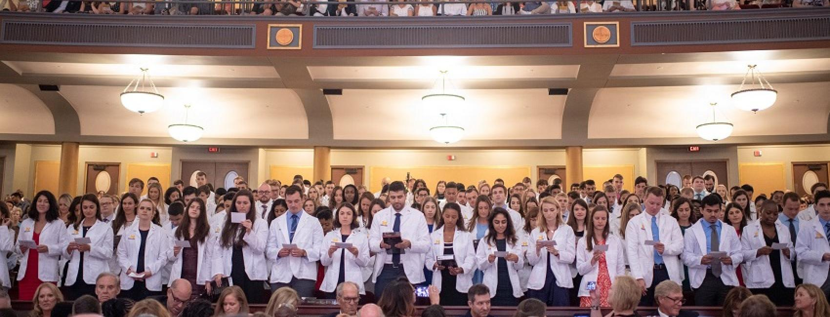 Incoming students with their white coats