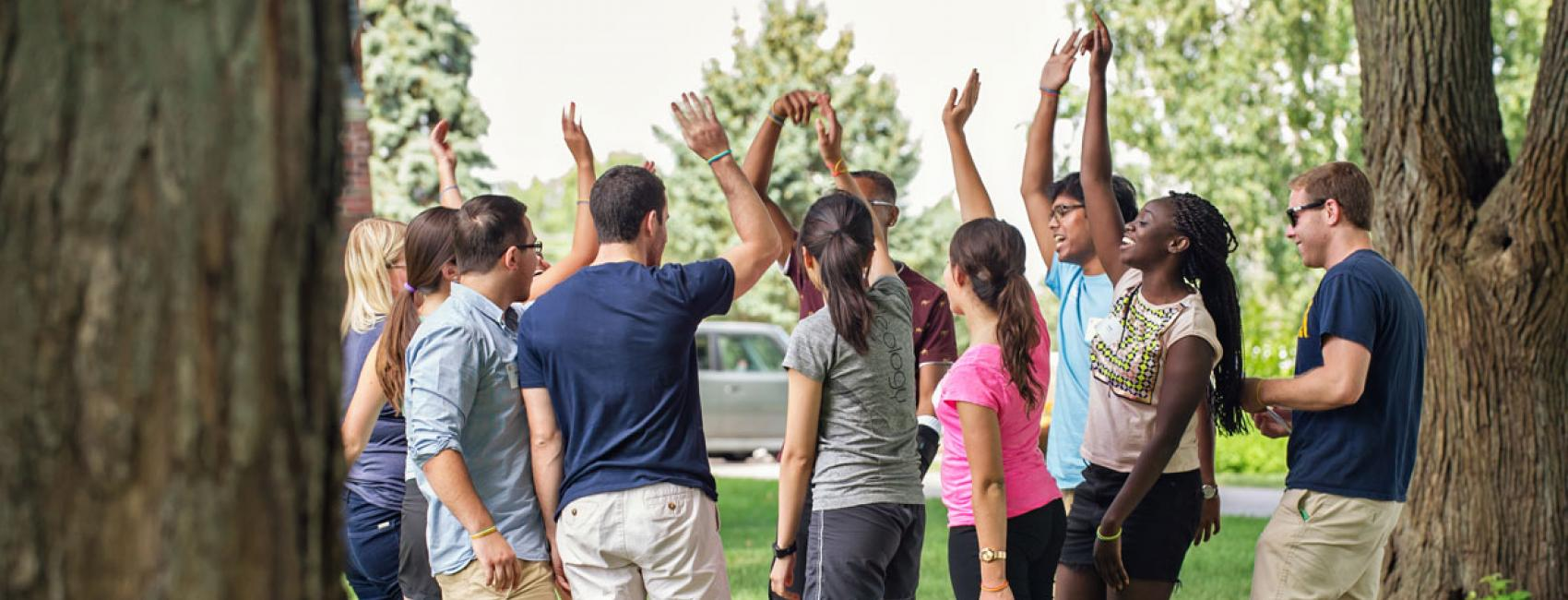 Students high-five at a leadership day activity