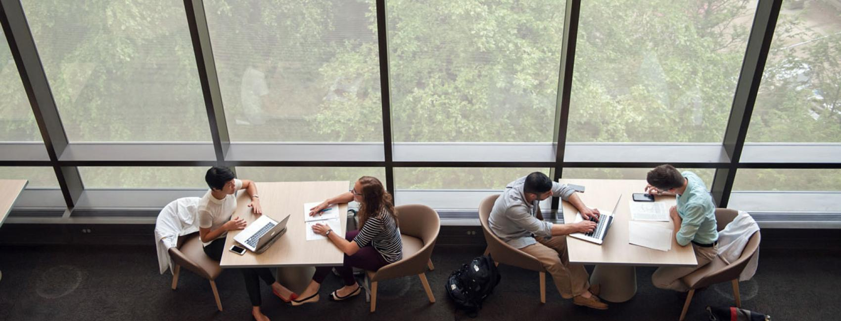 Students studying in the Taubman library