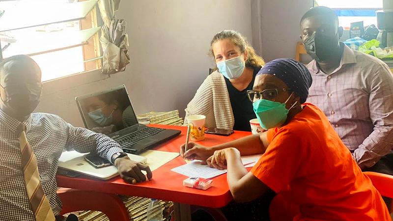 Ann Wolski (center, rear) and her Ghanaian research colleagues, including project mentor Dr. Ashura Bakari (center, front)