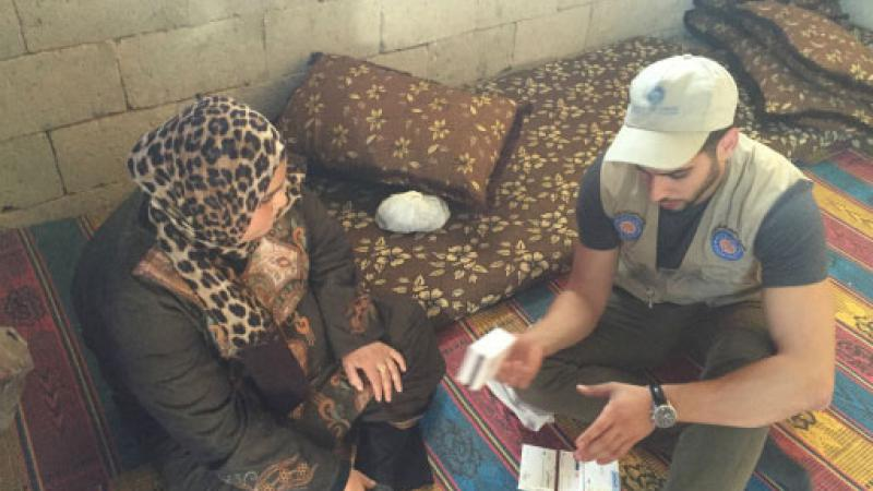 Medical student talks with woman in the West Bank