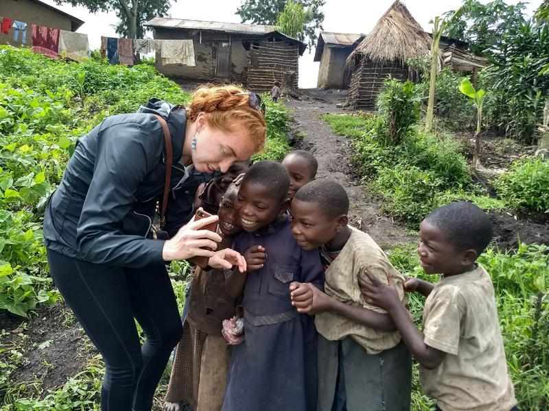 Medical student with children in Uganda