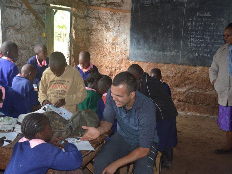 Medical student with school children in Kenya