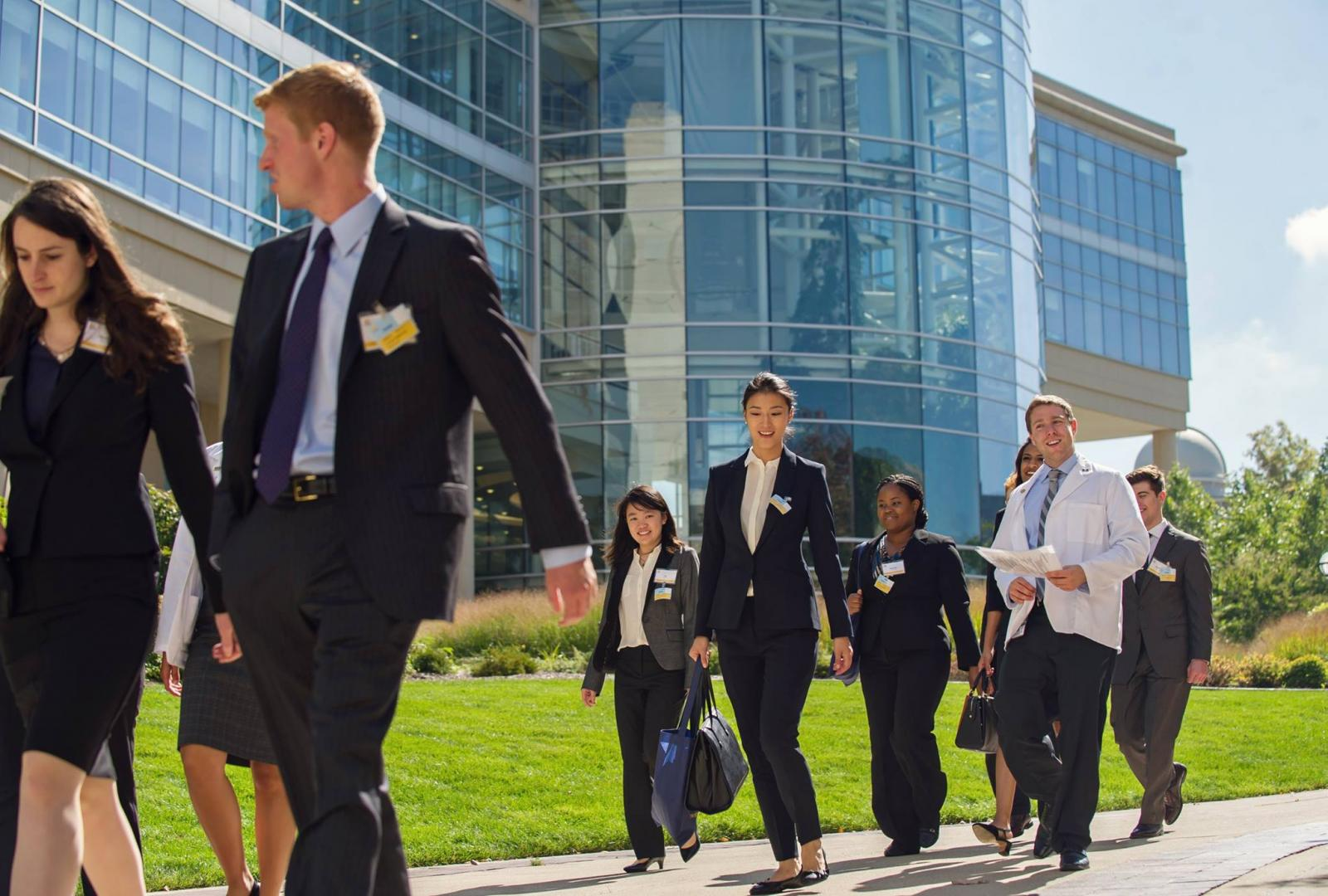 Visiting students walk past the Cardiovascular Center