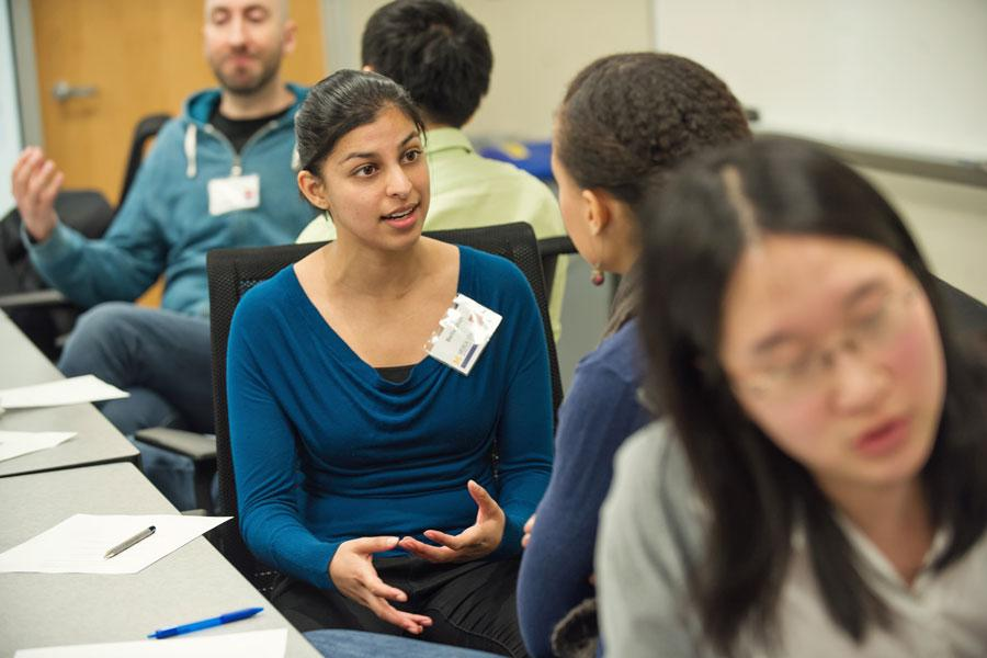 Students talk in a professional development workshop