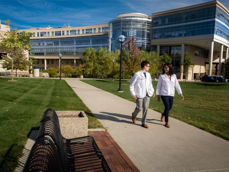 Students walk past the Cardiovascular Center