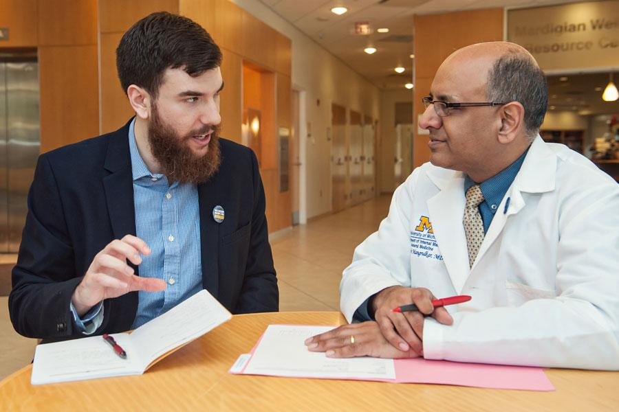 Dr. Mangrulkar talks with a medical student