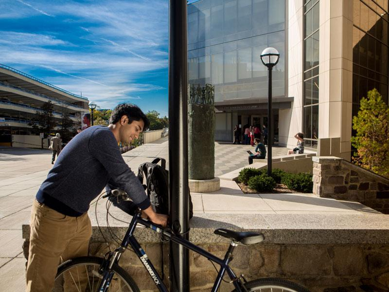 Student parks bike outside Taubman library