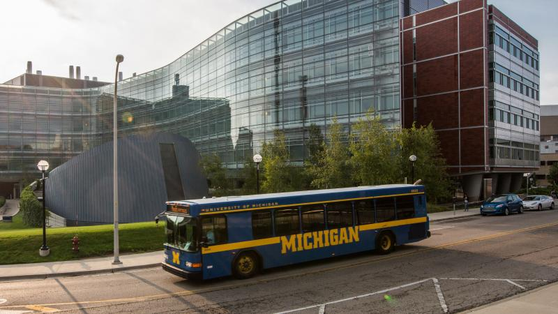 University of Michigan blue bus stops by the Biomedical Sciences Research Building