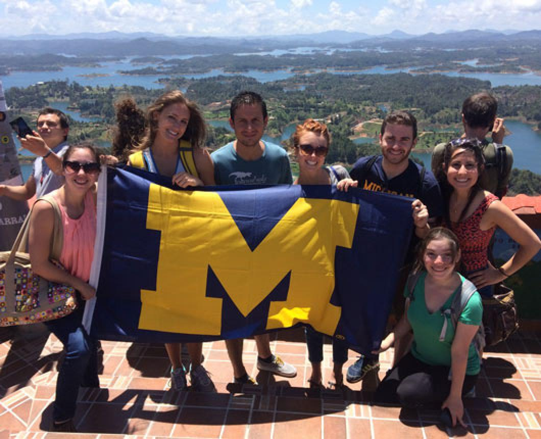 Michigan students hold a block-M flag in Colombia