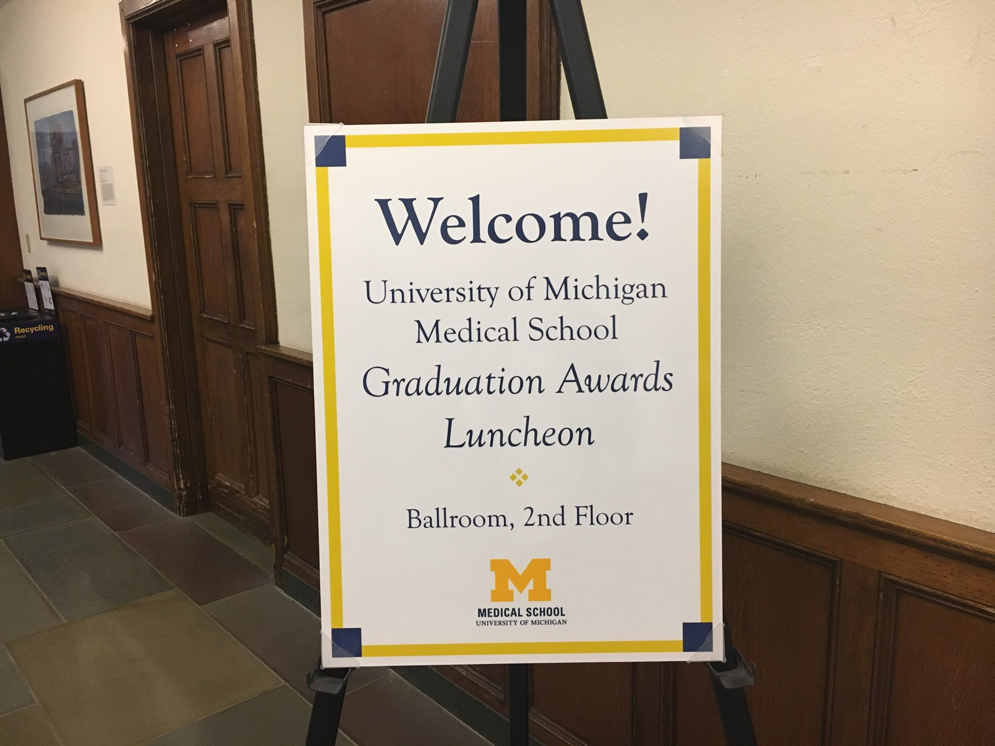 Sign welcoming graduates to luncheon