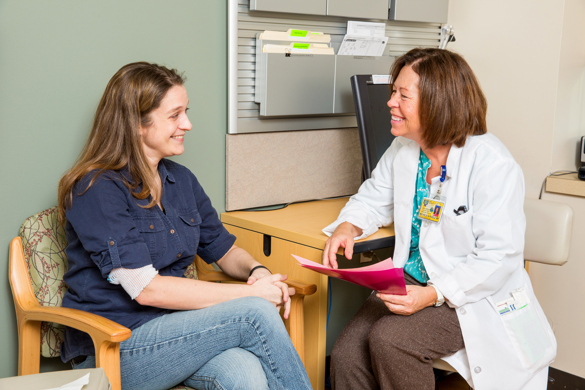 Nurse Practitioner Michele Poole with patient
