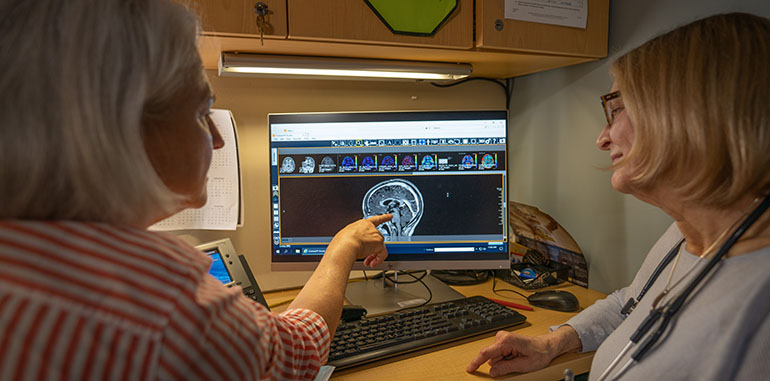 Doctors looking at medical imaging of a brain