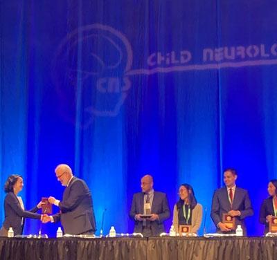 Giulia Benedetti receiving pediatric neurology award