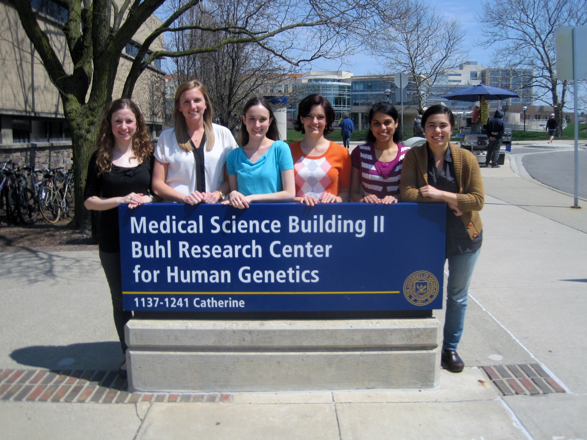 Genetics Counseling Students in front of department sign.