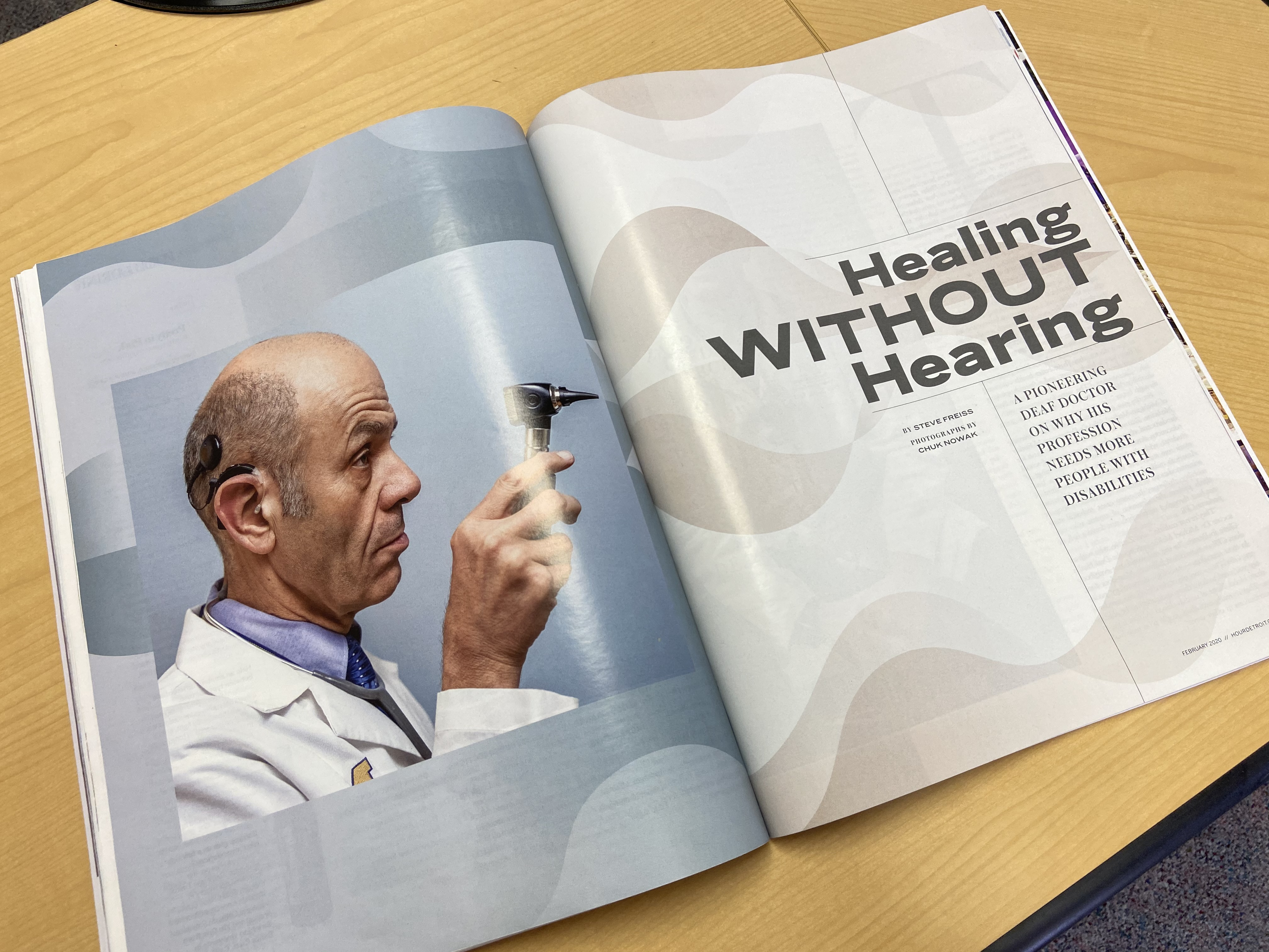 "An image of a magazine spread. THe left side features a picture of Dr. Zazove holding and otoscope, his cochlear implant visible. The right side reads ""Healing WITHOUT Hearing A Pioneering Deaf Doctor on Why His Profession Needs More People With Disabilit"