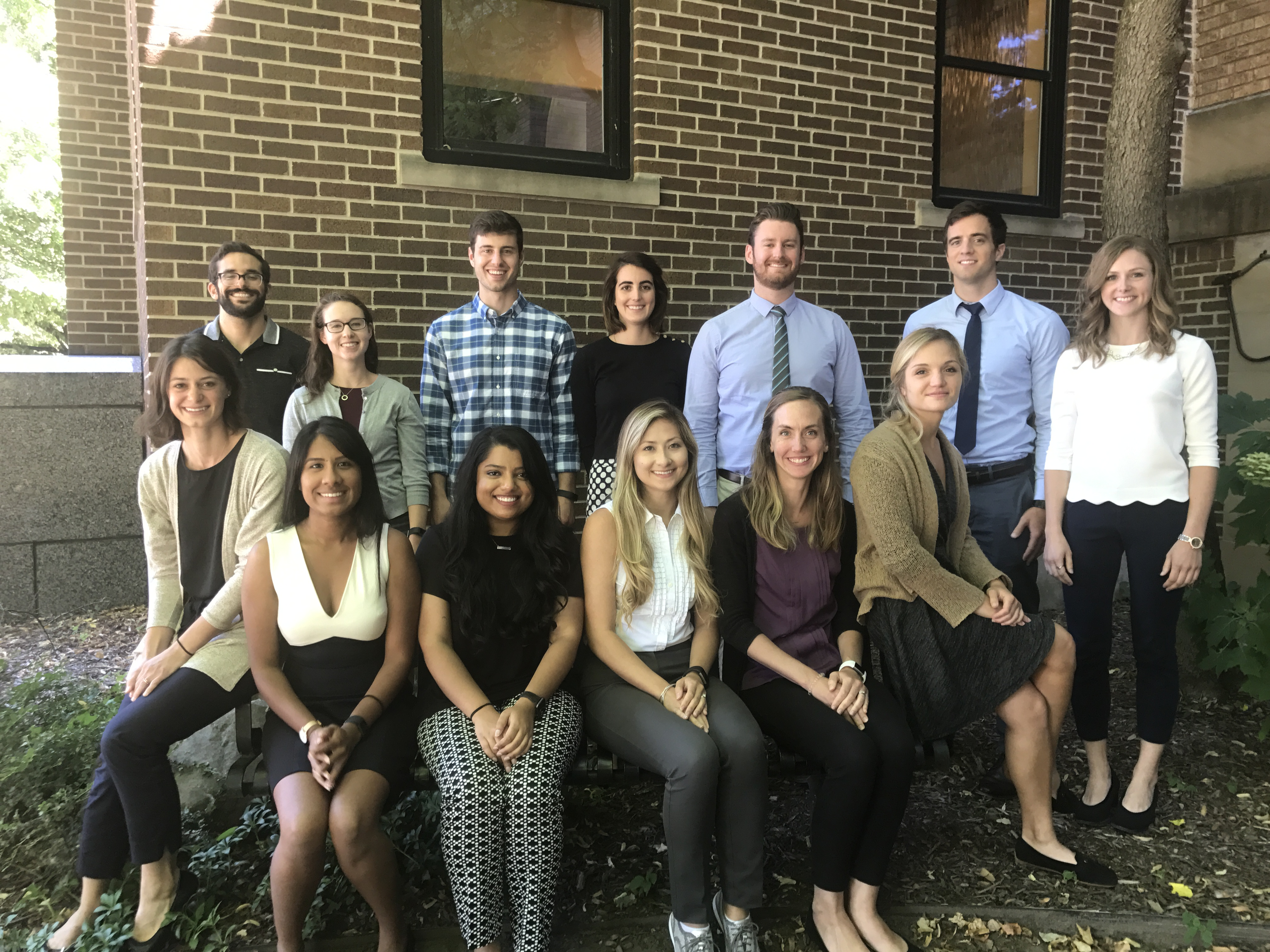 Resident Class of 2012-13 young physicians stand in a group outside.