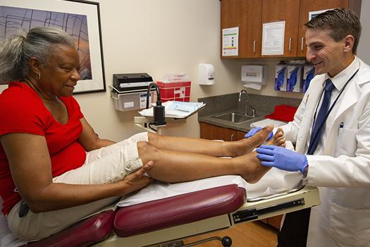 Dr. Brian Schmidt with a patient