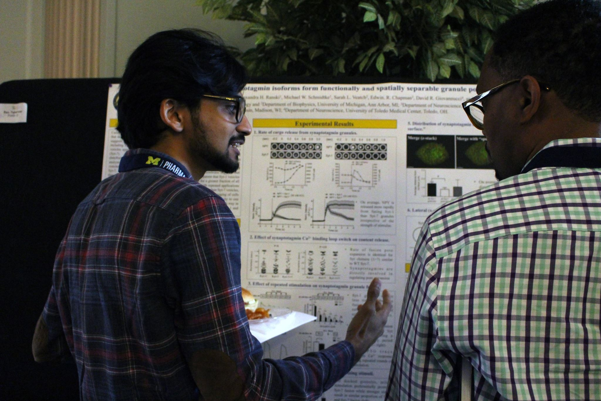 Drs. Tejeshwar Rao (Anantharam Lab) and Kevin Jones discuss research at the department's 125th anniversary