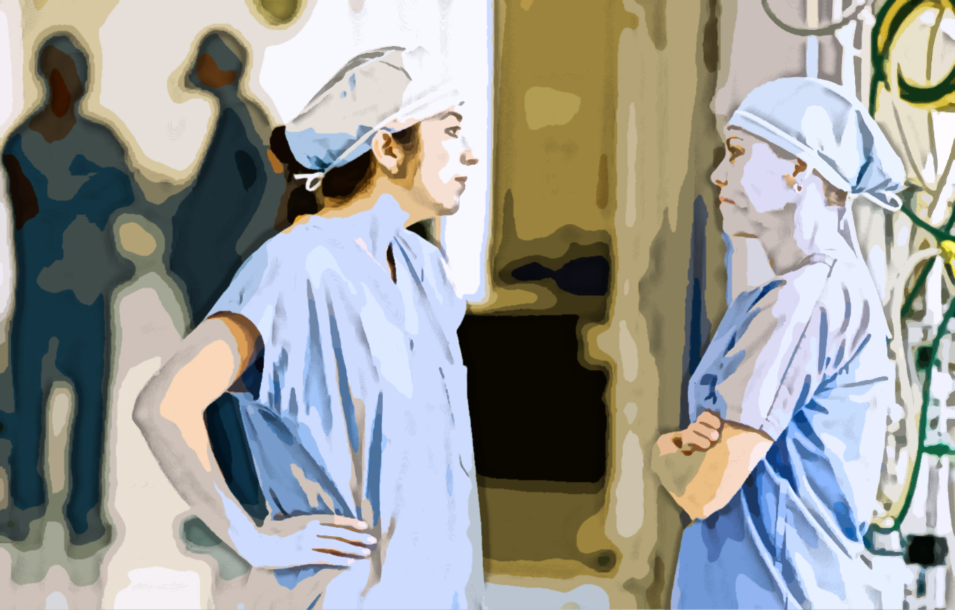 Two women seen in surgical scrubs having a disagreement