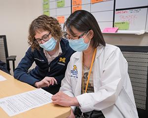 Trainees looking at paperwork