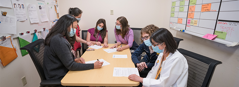 Fellowship physicians studying in an office