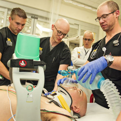 Emergency Medicine residents assist with chest compression