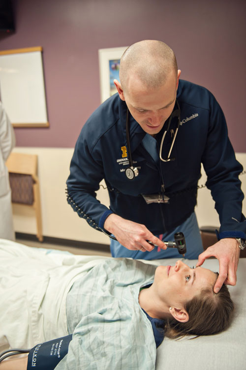 Emergency Medicine resident with a patient