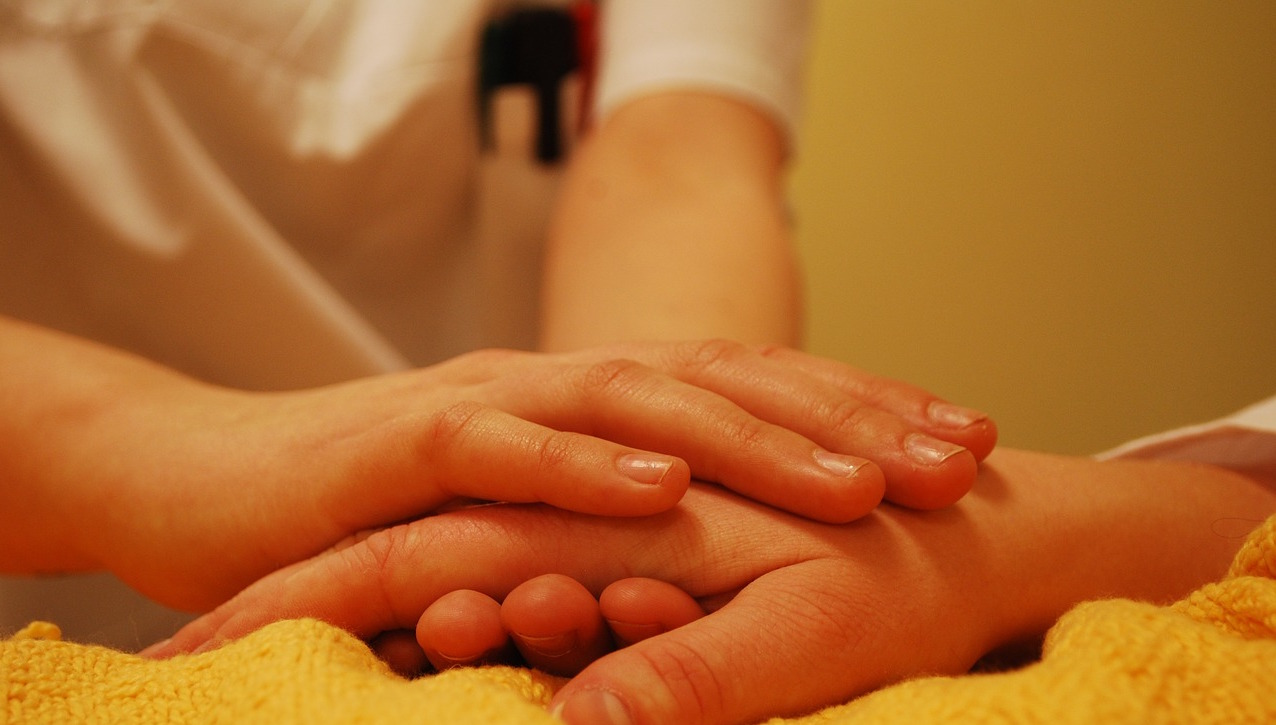 header image of medical professional comforting patient
