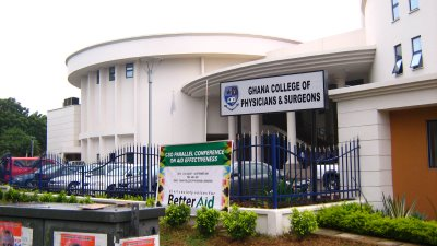 image of building with sign reading ghana college of physicians and surgeons