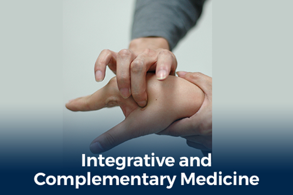 acuppressure on hand with text reading integrative and complementary medicine