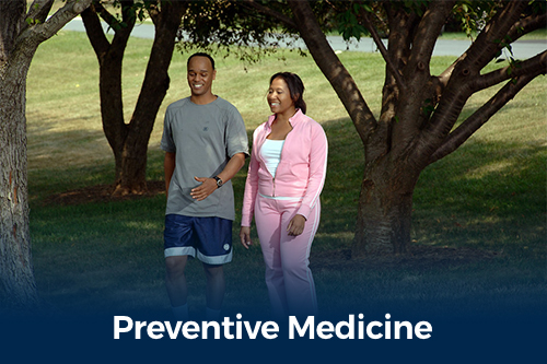 A man and woman walking outdoors with text Preventive Medicine