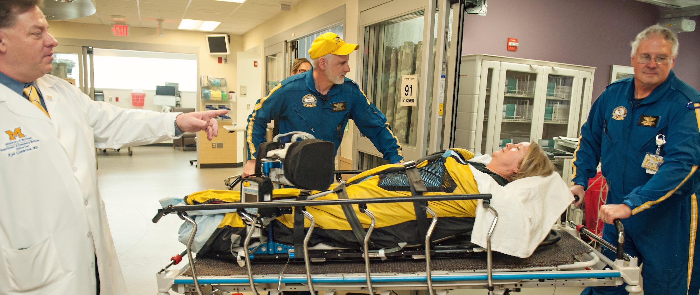 Emergency room critical care team with patient on stretcher
