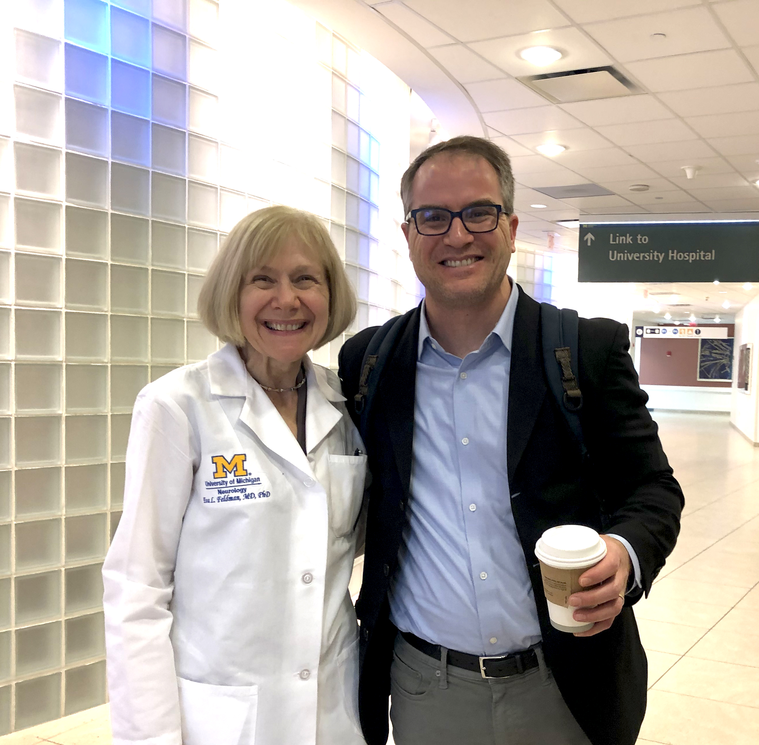 photo of Dr. Eva Feldman of the NeuroNetwork for Emerging Therapies and Dr. James Dowling of the University of Toronto after he gave Neurology Grand Rounds at Michigan Medicine