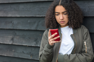 young woman looking at cell phone