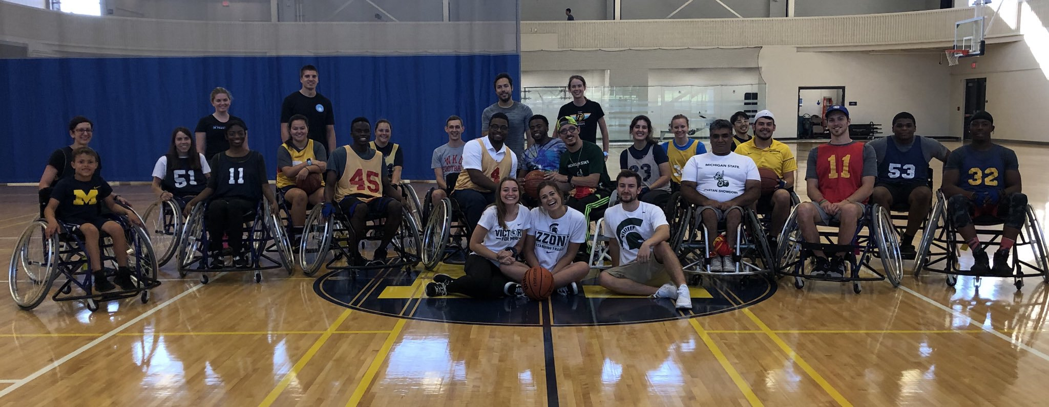 Dr. Okanlami with the MSU and U-M Adaptive Basketball teams