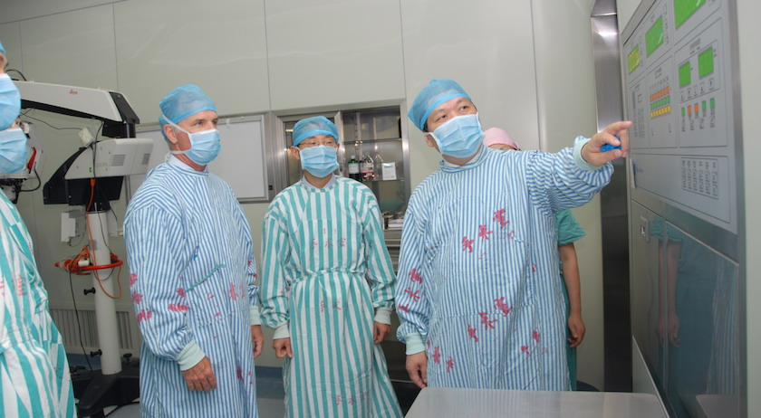 Dr. Mulholland and a group of surgeons in China