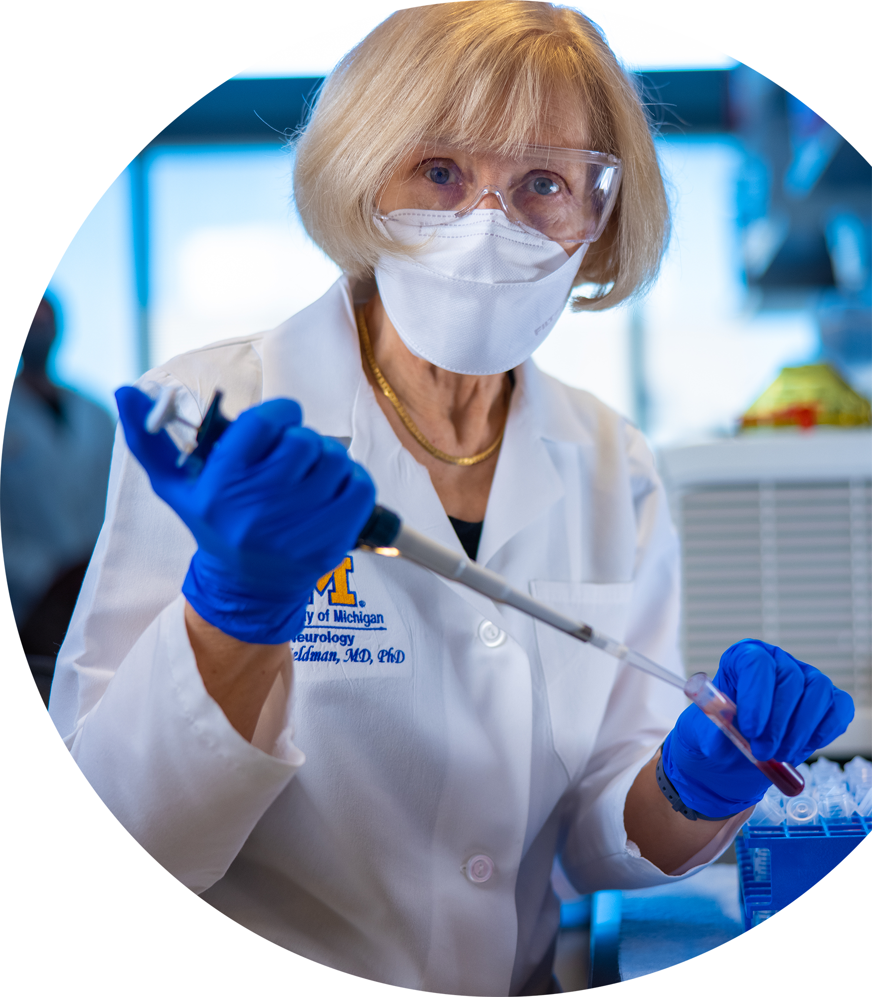 Michigan Medicine NeuroNetwork for Emerging Therapies Director Dr. Eva Feldman working in the lab with a face mask image
