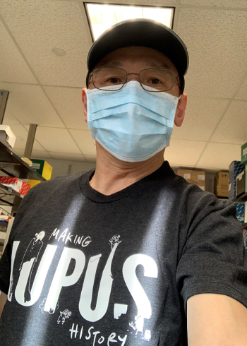 Dr. Bin Xu modeling our new lab t-shirt