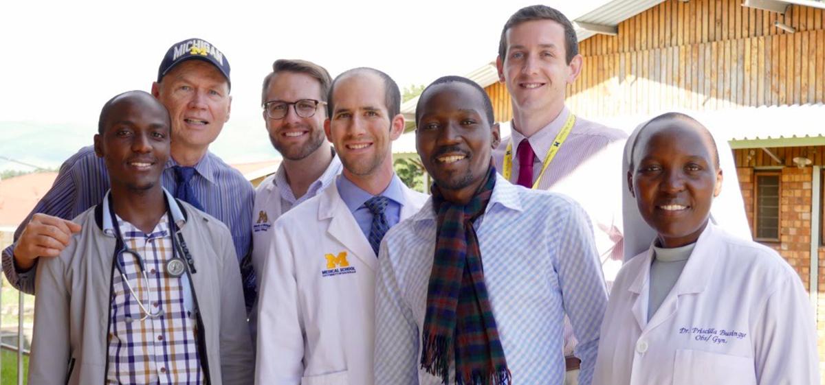Joseph Kolars with UMMS students and partners in Uganda, 2018