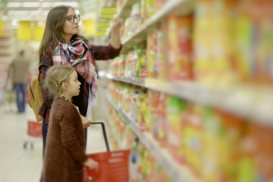 A girl in the supermarket with her mom