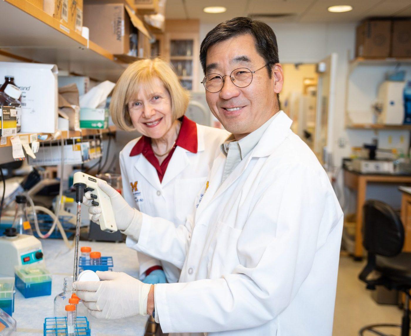 Eva Feldman, M.D., Ph.D., in the lab with Bhumsoo Kim, Ph.D.
