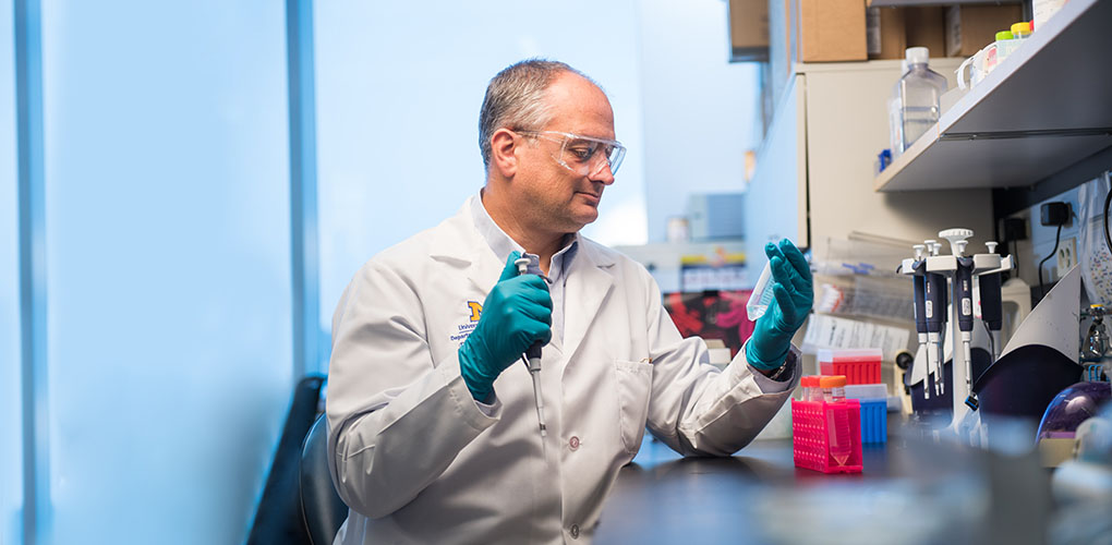 Dr, David Antonetti performing research in his lab