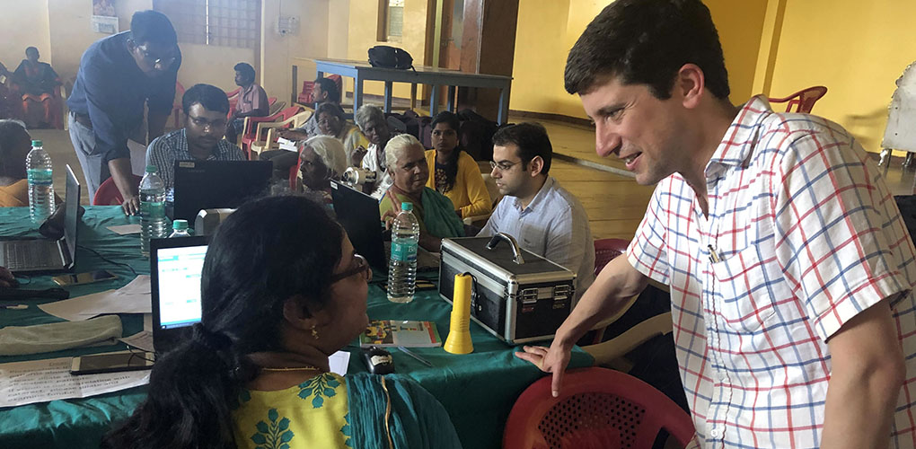 Joshua Ehrlich, M.D., M.P.H., visiting with colleagues at the Aravind Eye Care System in India.