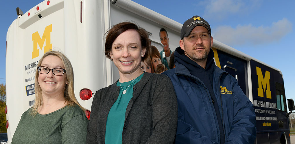 Kelley Lathrop, RAHS ancillary care coordinator, with Courtney Dewey, O.D., and Adam Burgess, RAHS mobile unit driver.