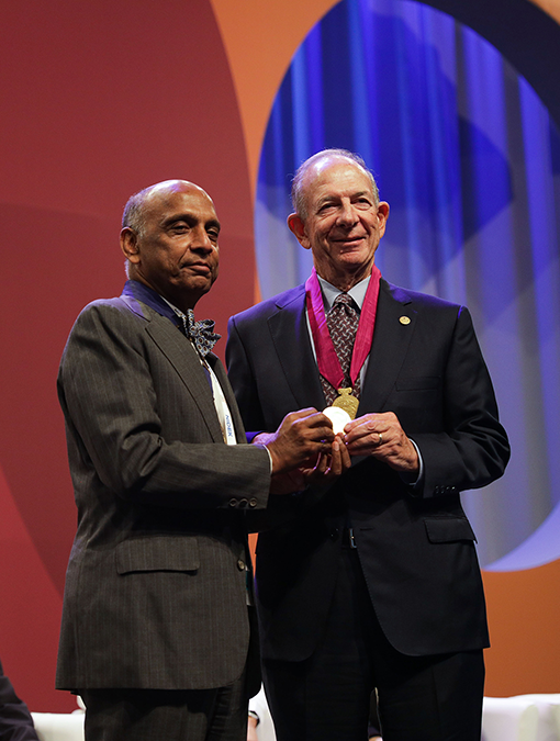 The President of Academia Ophthalmologica Internationalis, Prof. Gullapalli N. Rao presenting the Bernardo Streiff Gold Medal to Paul Lichter, MD, MS