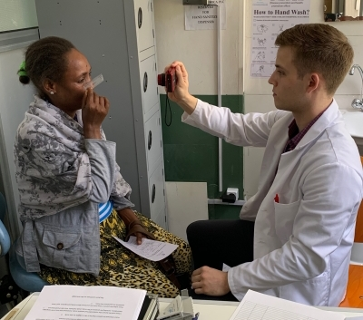 Curtis Heisel and patient at St. Paul's Hospital in Ethiopia