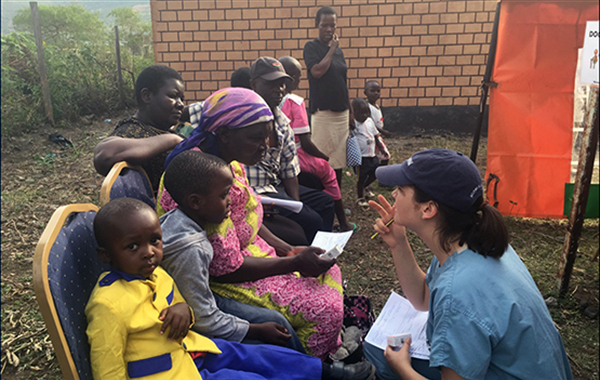 Chelsea Reighard, 4th year UM medical student, screening patients during a four-week outreach in Kenya
