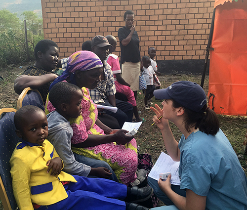 Chelsea Reighard, medical student, with patients at the Tenwek Eye Clinic in Kenya